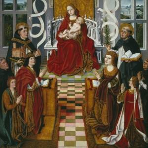 """""""La Virgen de los Reyes Católicos"""", tabla realizada entre 1491 y 1493. En ella observamos en un lugar central a la Virgen y a ambos lados a los Reyes Católicos acompañados de sus hijos, el infante don Juan y la infanta Isabel."""